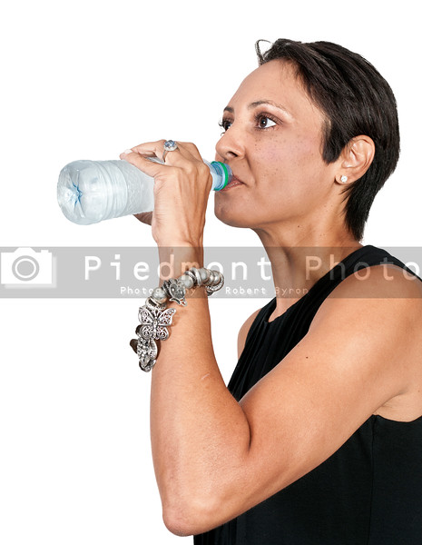 A beautiful young woman water from a plastic bottle