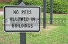 A sign stating No Pets Allowed In Building