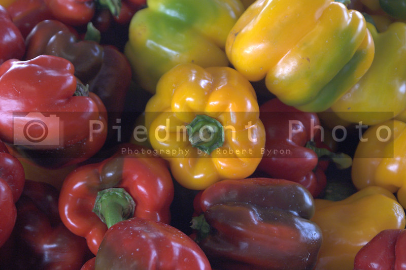 An assortment of colored bell peppers.