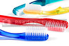 A series of colorful toothbrushes used for dental hygiene.