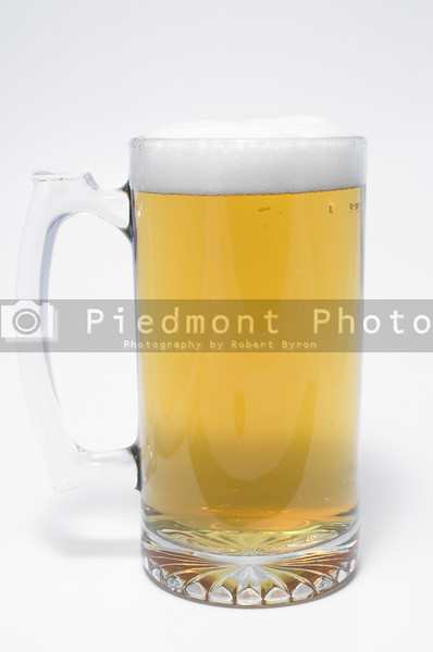 A glass mug of ice cold beer.
