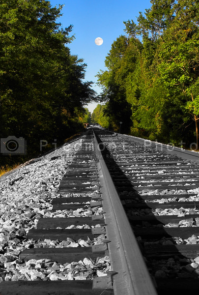 Full Moon over Black and White Train Tracks