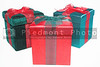 A set of colorful seasonal Christmas present gift boxes.