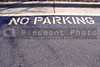 The words No Parking written on pavement.