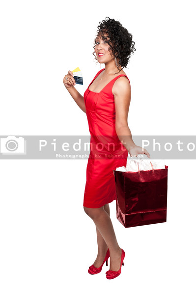 A young beautiful black African American woman on a shopping spree with credit cards