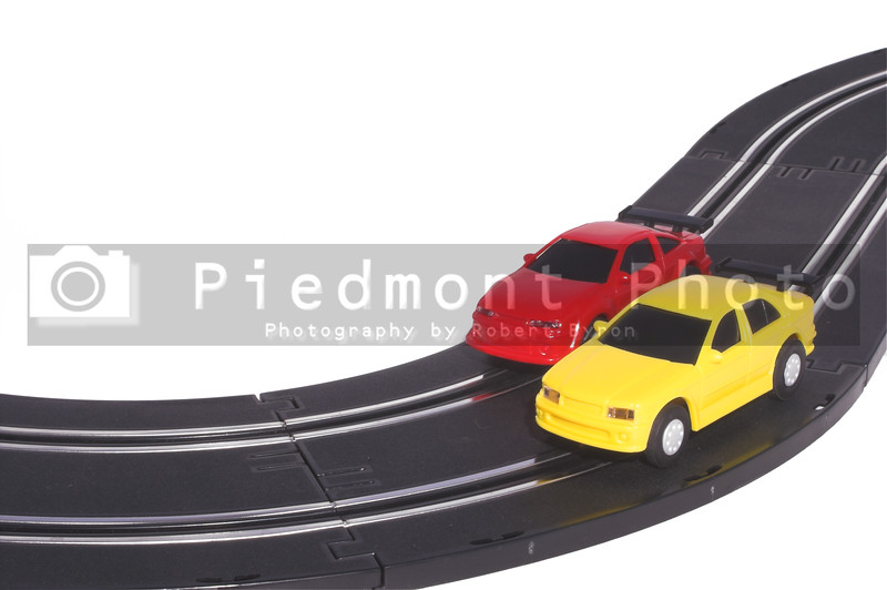 Two slot cars racing on a track.