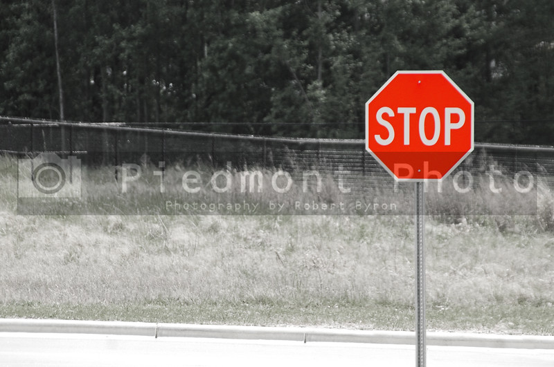A stop sign at the end of a road.