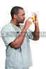 Young black African American man doctor in scrubs holding a urine sample