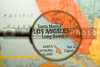 A map of Los Angeles seen through a magnifying glass.