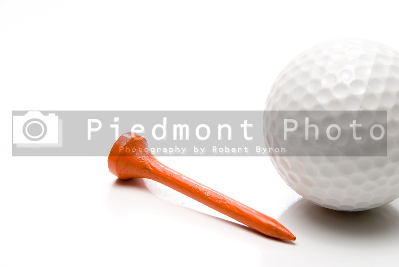 A golf ball and a golf tee.