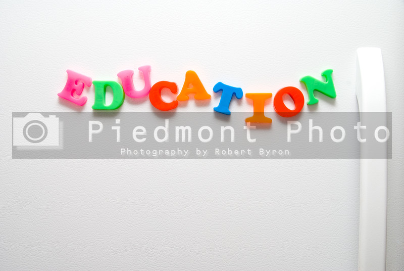 The word Education written with magnetic letters.