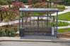 An empty bus stop waiting for passengers.