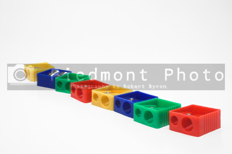 A row of colorful manual pencil sharpeners.