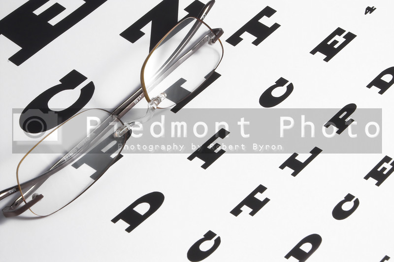 Vision Care Concept - a pair of glasses and eye chart.