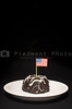 A piece of chocolate cake with the American flag.