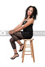A very beautiful African American woman on a stool