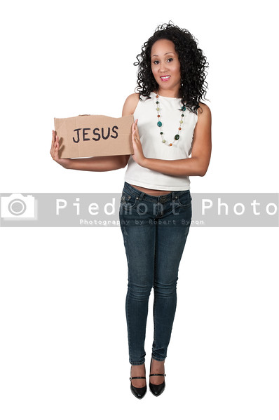 A beautiful young black woman holding up a Jesus sign