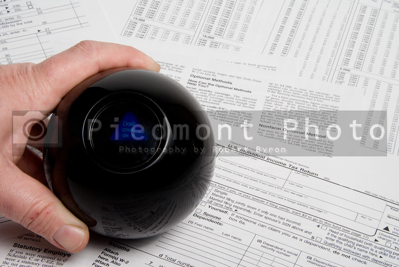 Using a magic ball to predict an incom tax outcome.