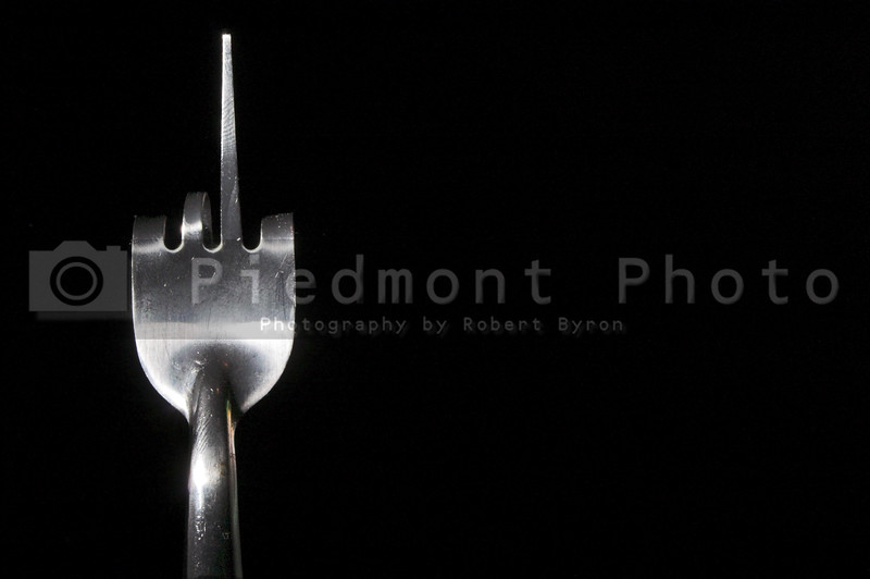 A dinner fork making an obscene gesture.