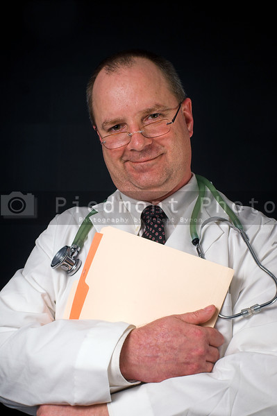 A medical doctor holding a patient's chart.