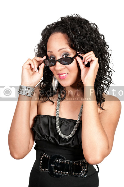 A black woman sporting a pair of sunglasses