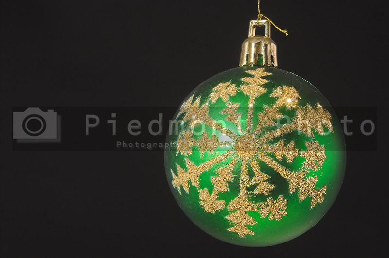 A very colorful Christmas ornamental glass ball.