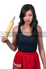 Beautiful young Asian woman chef holding a rolling pin