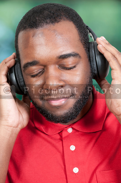 Handsome man listening to a set of headphones