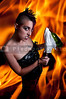 Beautiful rebellious punk rock woman throwing a molotov cocktail