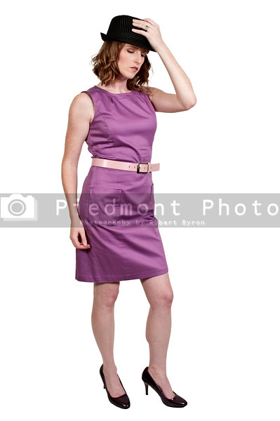 Beautiful young woman in a sleeveless mod dress