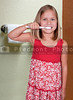 Beautiful little girl exercising good dental hygiene by brushing his teeth