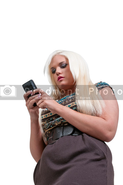 A beautiful young woman using a cell phone for texting