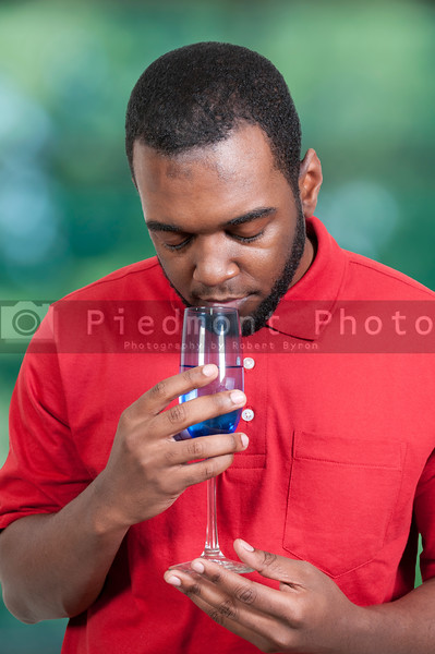 Black African American man holding a wine glass