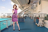 Beautiful young woman in a sleeveless mod dress on a cruise ship
