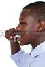 Handsome teenage boy exercising good dental hygiene by brushing his teeth