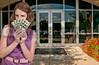 Beautiful woman holding a hand full of 100 dollar bills