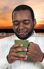 Young black African American man drinking coffee