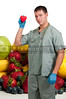 Man doctor with a wide assortment of delicious and fresh fruits