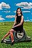 Beautiful young teenage girl sitting on a huge bearing