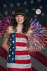 Beautiful woman at a fireworks display wrapped in a flag