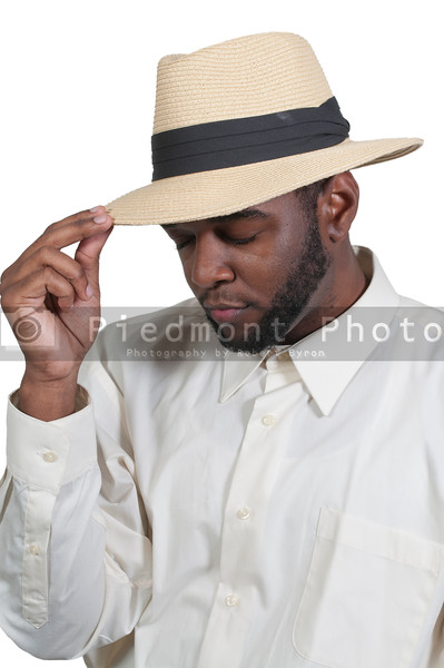 An attractive handsome African American black man in a fedora hat