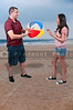 Young couple playing with a beach ball