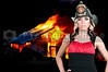 Beautiful young woman firefighter at a fire