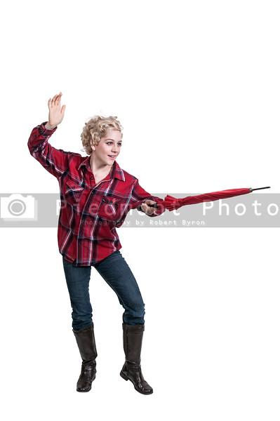 Beutiful woman sword fighting with an umbrella
