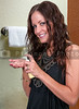 Beautiful woman applying hand lotion or cream
