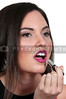 Beautiful young woman applying makeup and lipstick