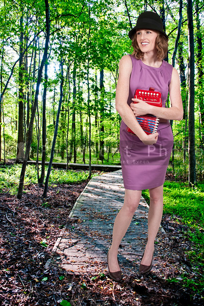 Beautiful woman holding an accordian toy