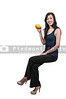 Beautiful young woman sitting with a lemon