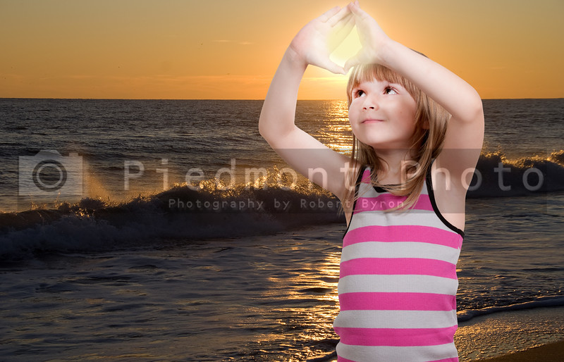 Beautiful young little girl hanging the sunset