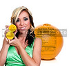 Beautiful woman with a slice of a fresh and juicy orange